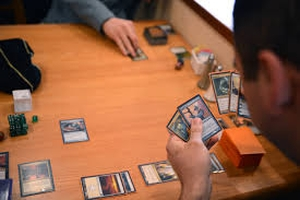 Take a look at Magic The Gathering Deck Builder 19